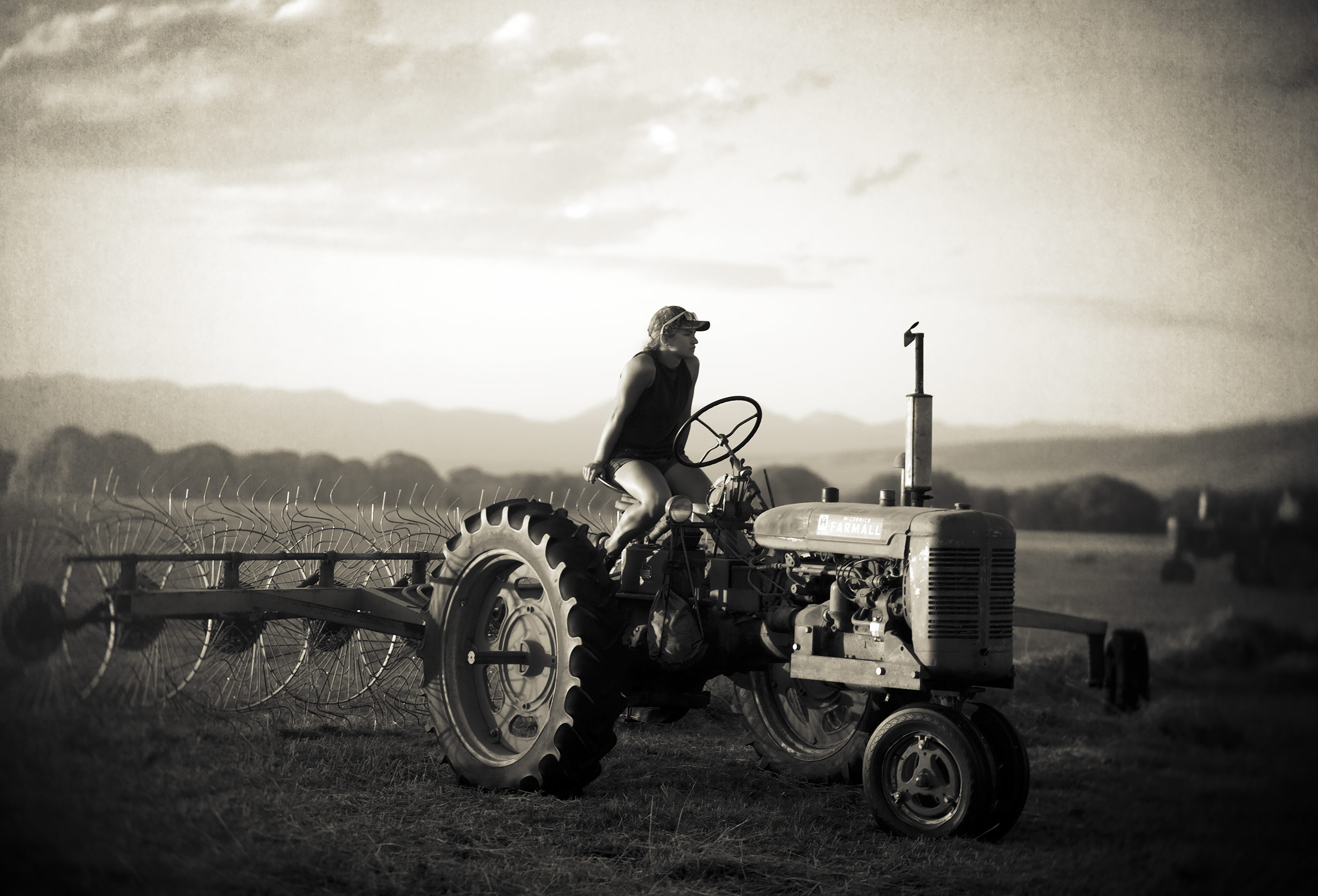 Ranch Hand on a Tractor in Montana