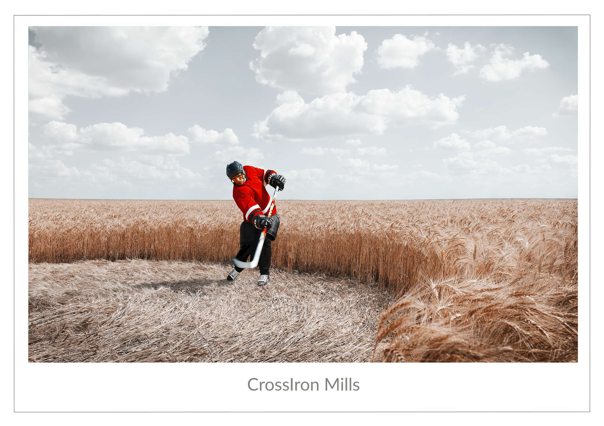 Hockey player wearing a red jersey and playing hockey in the middle of a wheat field in Texas