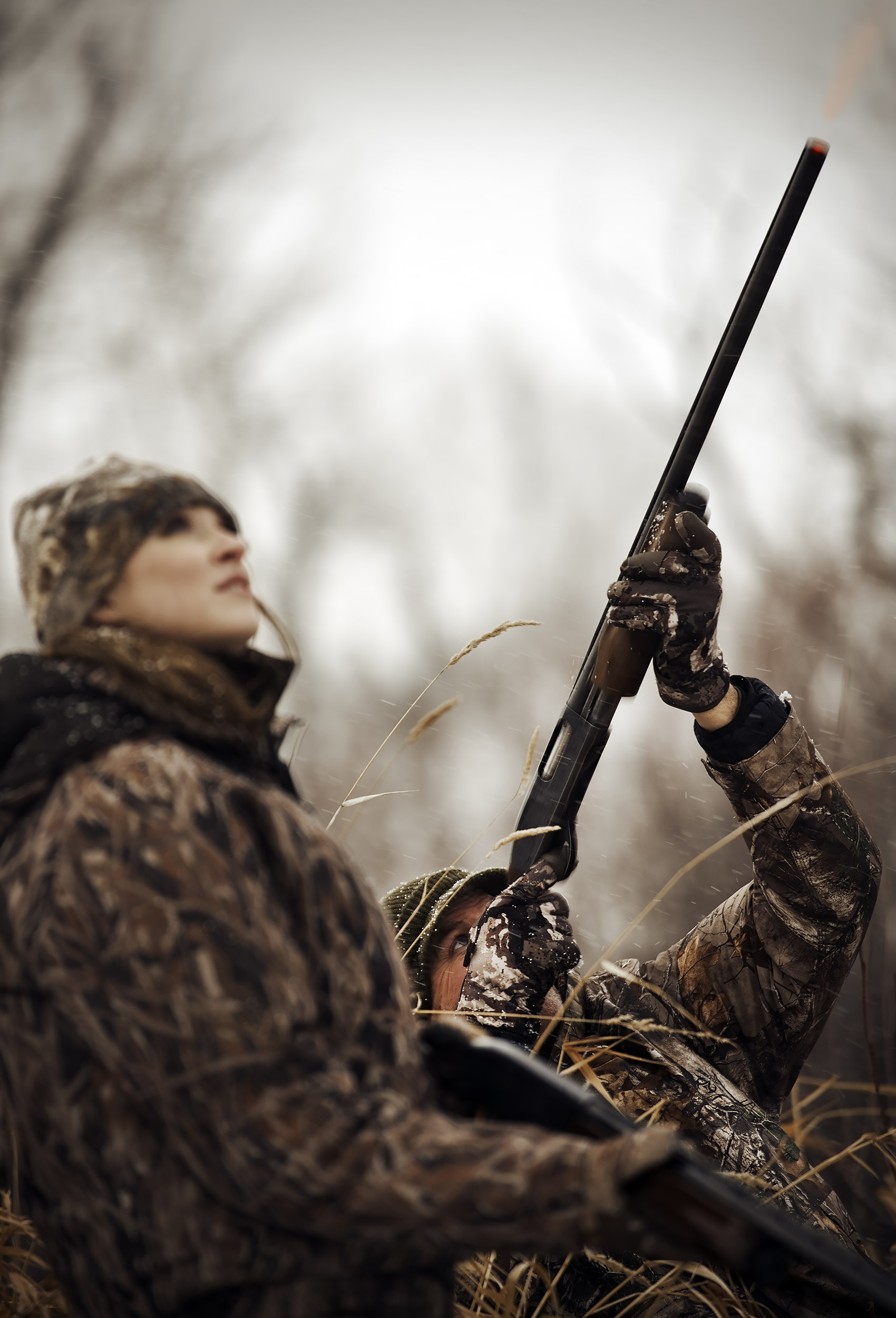 Father and daughter duck hunting together in a duck blind