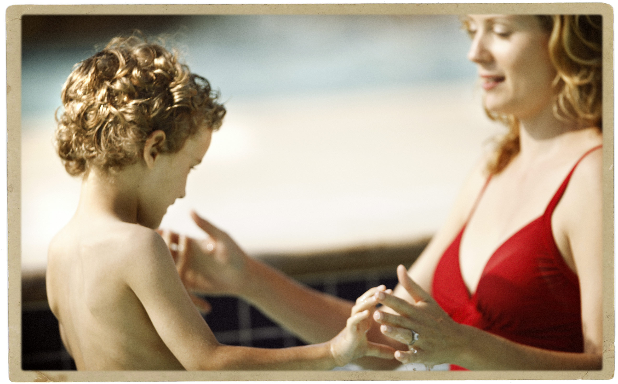 Child with Mother in a Swimming Pool