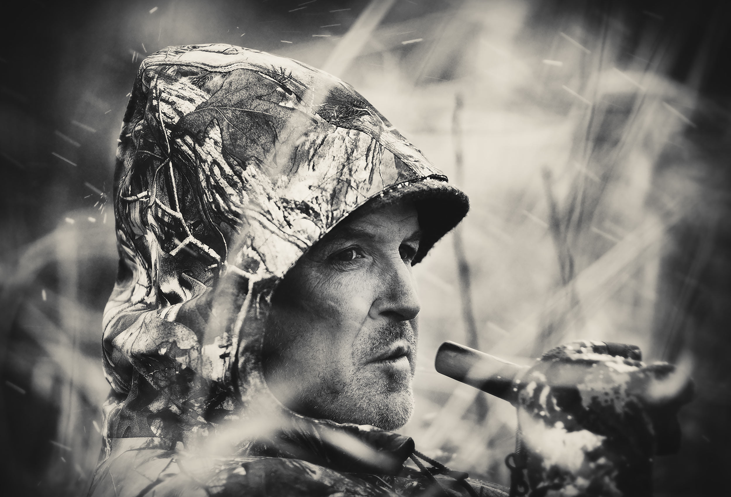 Duck hunter in a blind looking up towards the sky