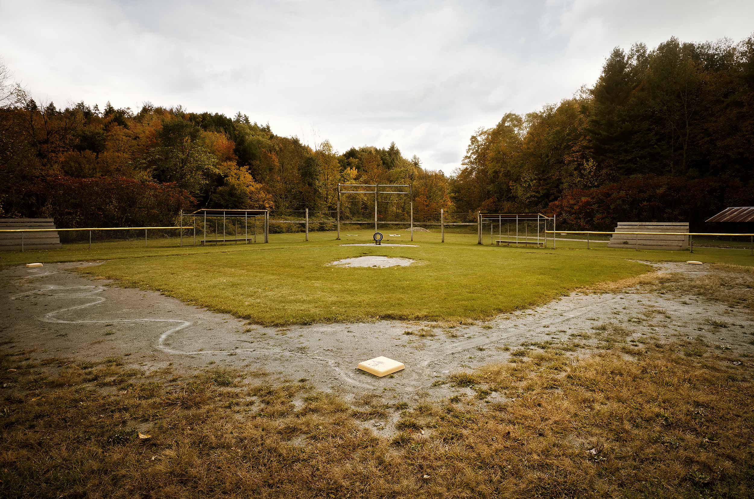 An empty baseball diamond in Vermont during the fall