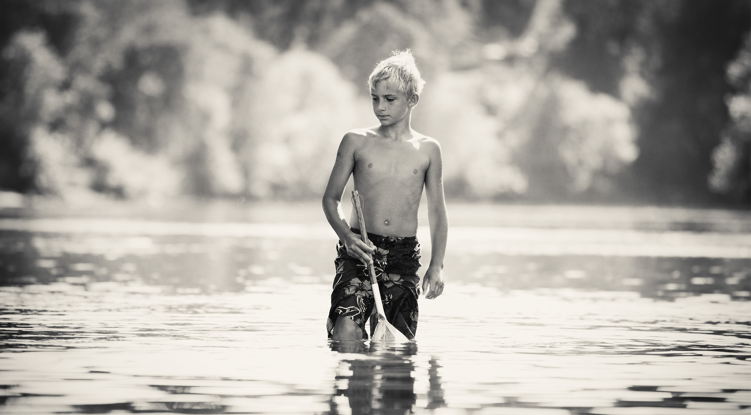 Boy standing with a net in the Umpqua River