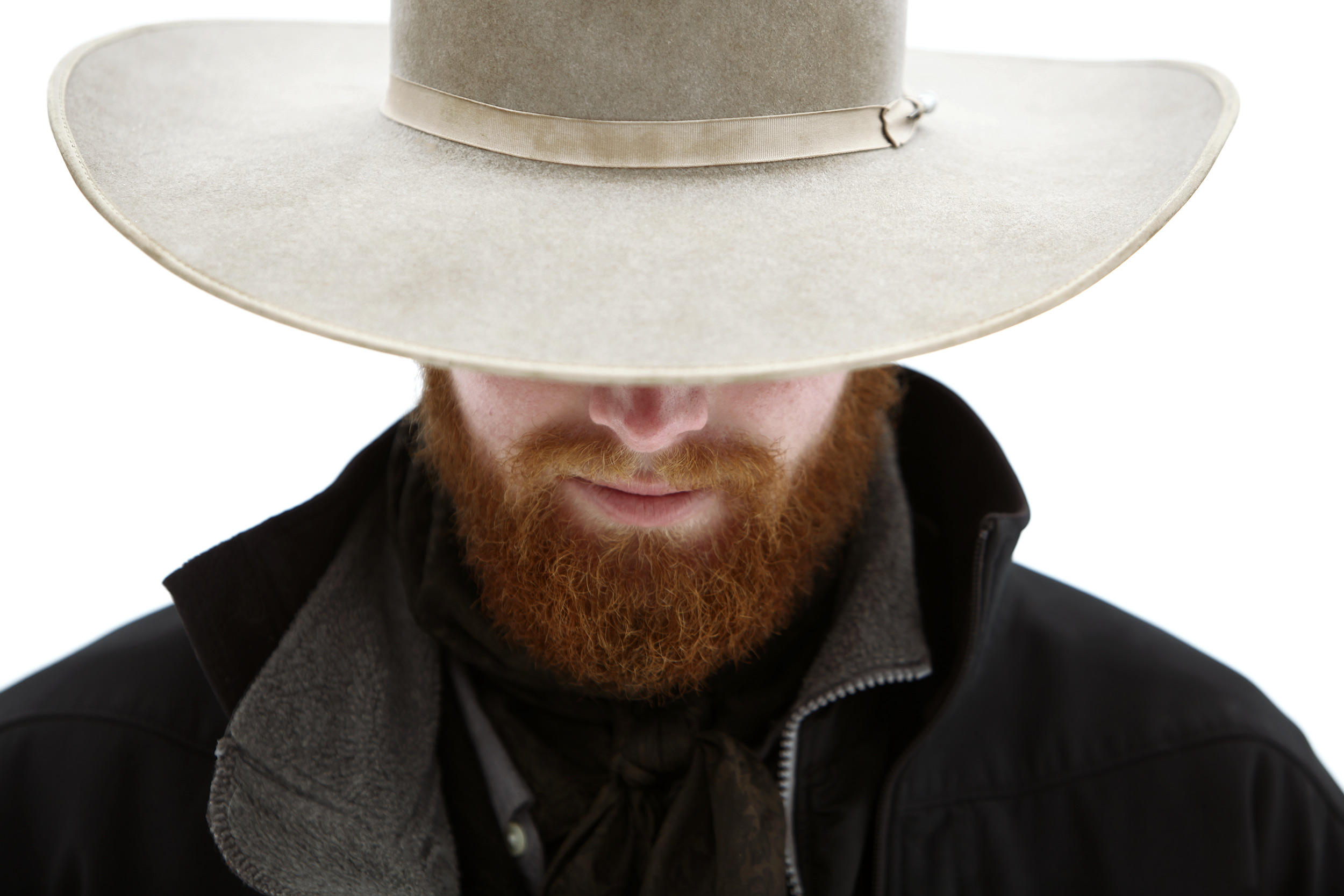 Portrait of a cowboy with a red beard looking down