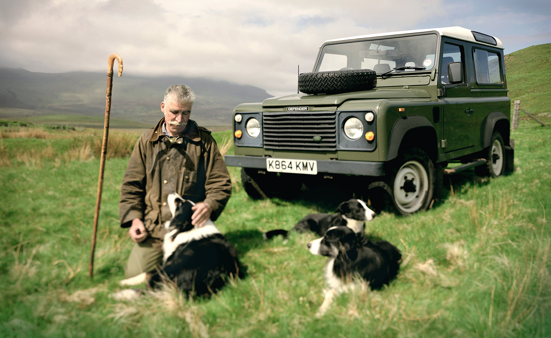 Scottish herdsman with his dogs on the Isle of Skye