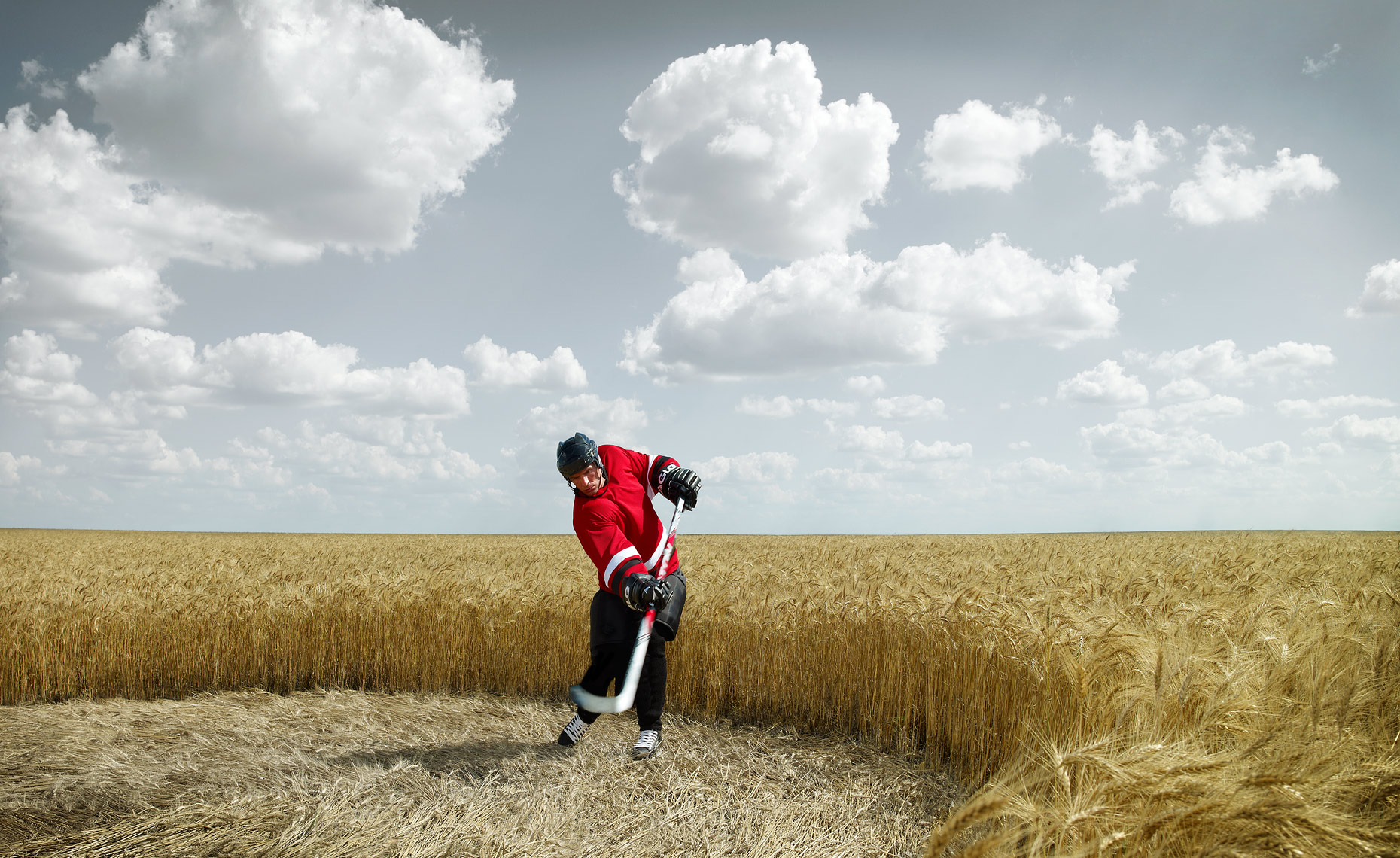 Hockey Player in a wheat field - Cross Iron Mills