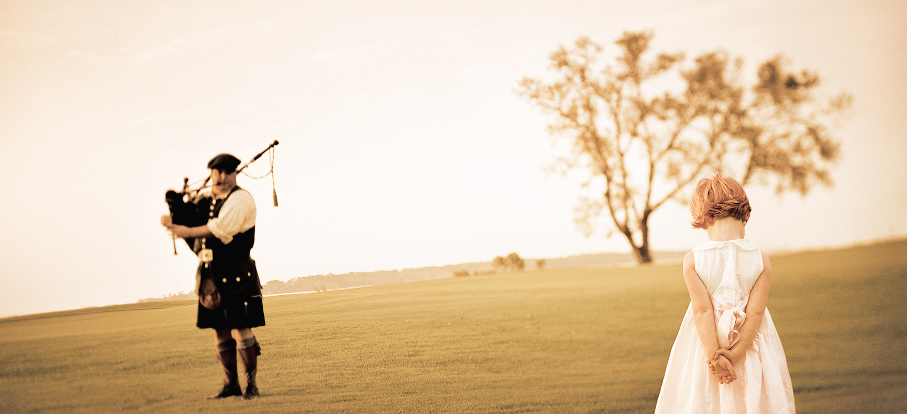 Bagpiper and a little girl - Sea Island Resort