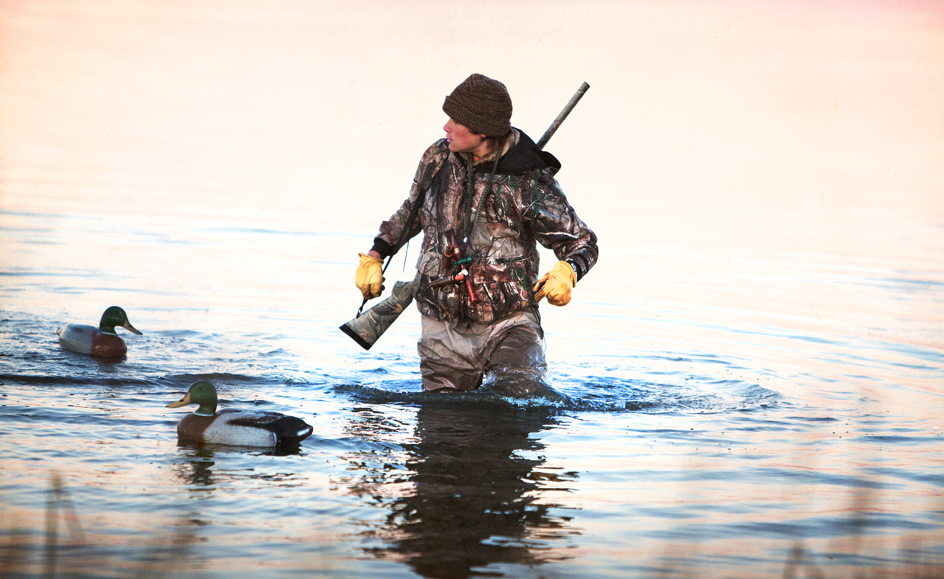 Young duck hunter setting decoys